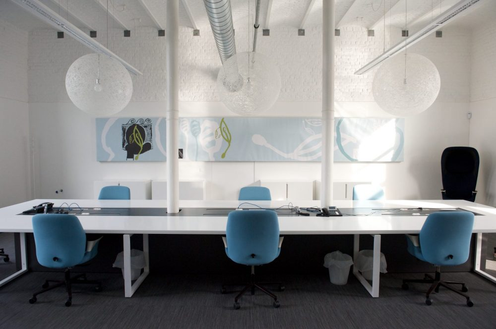 white office space, white offices, bleu chairs, white light suspensions