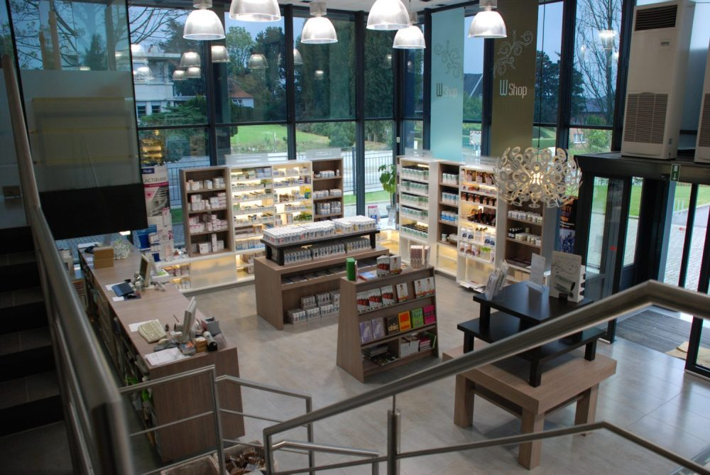 shop interior with wooden tables, rayons and displays