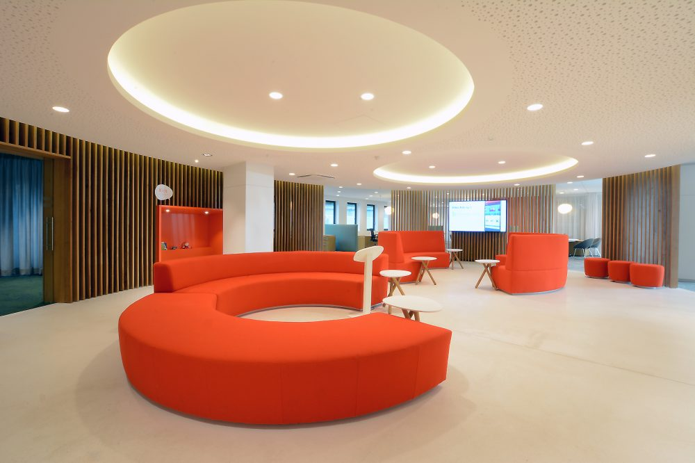 waiting lounge orange furniture, white floor, wooden slatwall