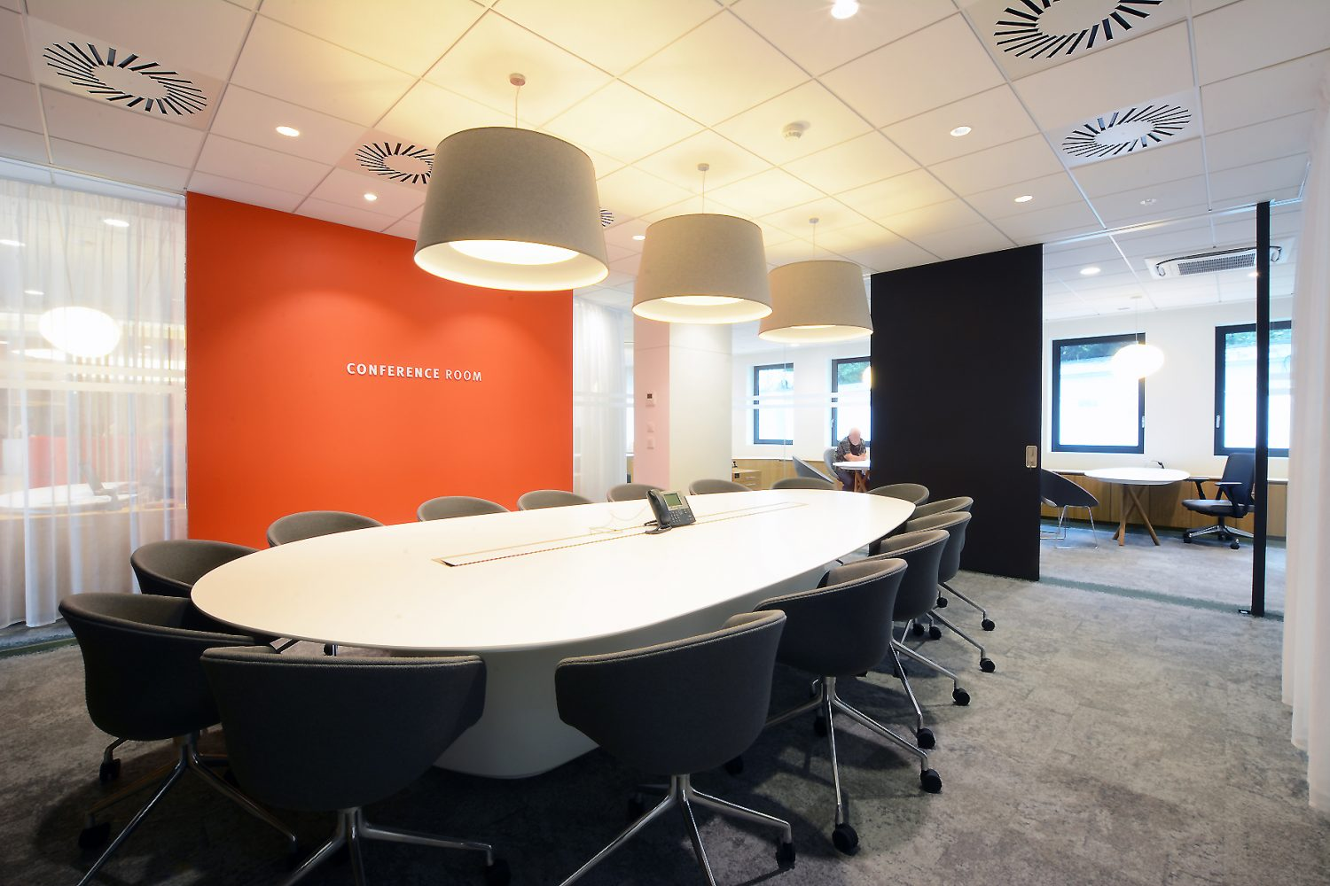 meeting table white and orange wall