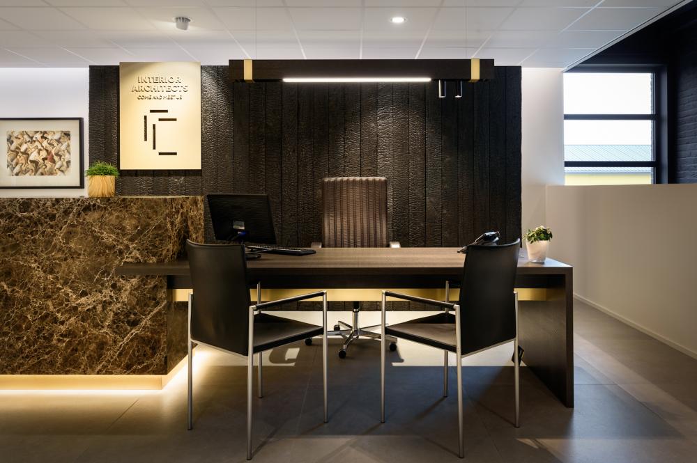 marble block office, black burn wooden wall, logo Cockaert